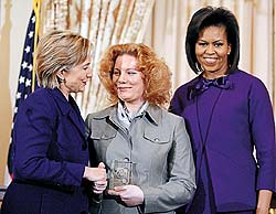 "Mrs. Veronika Marchenko (center), head of the Russian NGO Mother's Right, accepts the ""Women of Courage"" award from Secretary of State Hillary Clinton and First Lady Michelle Obama in Washington, DC, on March 11. The State Department's announcement of Marchenko's award said that she ""has demonstrated exceptional bravery and leadership in exposing the truth surrounding the disturbing peacetime deaths within the Russian armed forces."""